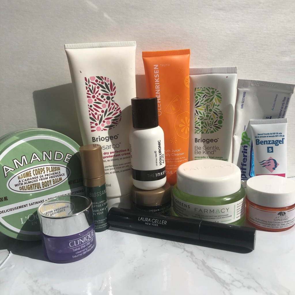A collection of empty makeup, skincare and hair products.
