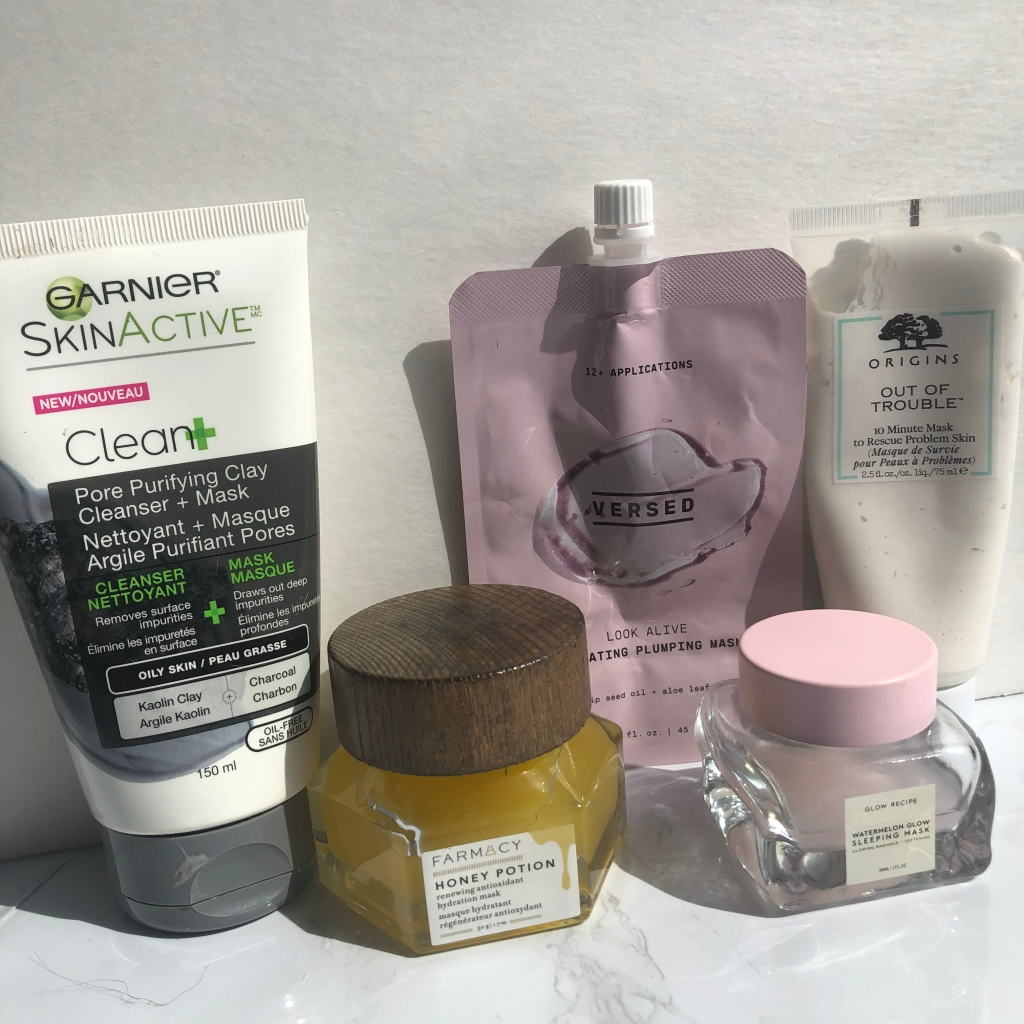 A collection of face masks from Garnier, Farmacy, Versed, Origins and Glow Recipe. Skincare for acne-prone skin.
